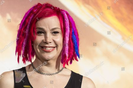 "Filmmaker Lana Wachowski attends the premiere of Warner Bros. Pictures' ""Jupiter Ascending"" at TCL Chinese Theatre in Hollywood, Calif. When the filmmaker siblings are asked what incites the biggest spats between the brother-sister duo best known for writing and directing ""The Matrix"" trilogy, Andy and Lana Wachowski provide a non-verbal response: They sweetly clasp each other's hands and tap their contrasting noggins - Lana's fuchsia-hued dreadlocks, Andy's wrapped-up bald head - together. ""It's all just love,"" said Lana. ""Is that too good to be believed"