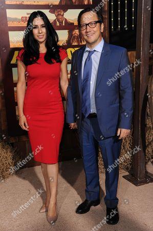 """Actor Rob Schneider, right, and Patricia Azarcoya attend a premiere of """"The Ridiculous 6"""" held at AMC Universal Citywalk, in Universal City, Calif"""