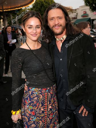 """Megan Ozurovich, left, and Clifton Collins Jr. arrive at the Los Angeles premiere of """"Transcendence"""" at the Westwood Regency Village Theater on"""