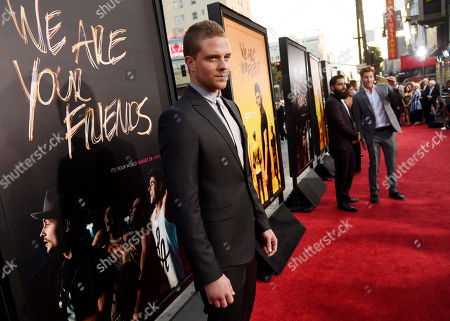 """Jonny Weston, a cast member in """"We Are Your Friends,"""" poses at the premiere of the film at the TCL Chinese Theatre, in Los Angeles"""