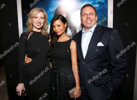 """Vice President and General Manager of Audience Network Patty Ishimoto, Thandiwe Newton and SVP of DirecTV Entertainment Chris Long arrive at the LA premiere of """"Rogue"""" at the ArcLight Hollywood on in Los Angeles"""