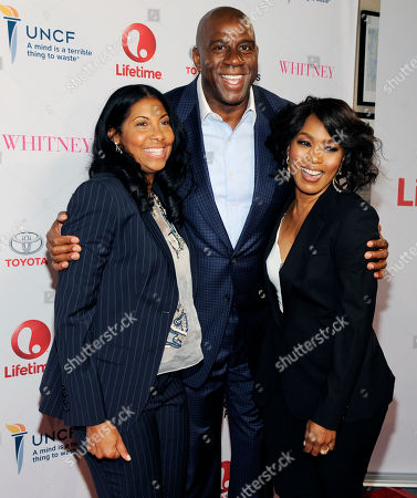 """Earvin """"Magic"""" Johnson, center, and his wife Cookie, left, pose with Angela Bassett, director of the Lifetime film """"Whitney,"""" at the premiere of the film at the Paley Center for Media, in Beverly Hills, Calif"""