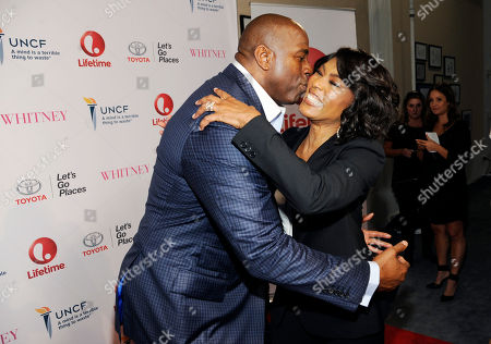"""Actress Angela Bassett, right, making her directorial debut with the Lifetime film """"Whitney,"""" is greeted by Earvin """"Magic"""" Johnson at the premiere of the film at the Paley Center for Media, in Beverly Hills, Calif"""