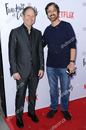 """Stock Image of Rob Burnett, left, and Ray Romano attend a special screening of """"The Fundamentals of Caring"""" held at Arclight Cinemas Hollywood, in Los Angeles"""