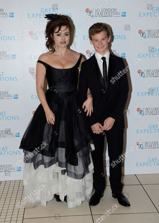 Helena Bonham Carter, Toby Irvine pose at London Film Festival Awards 2012 Closing Night Gala - Great Expectations at Odeon Leicester Square on in London