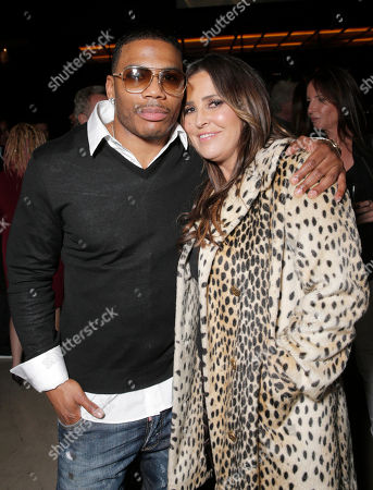 """Nelly and Jillian Barberie attends the Los Angeles Premiere of Millenium Entertainment's """"Reach Me"""" at Chinese 6 Theaters on in Los Angeles"""