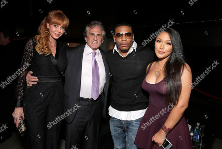 """Producer Rebekah Chaney, Director John Herzfeld, Nelly and Shantel Jackson attend the Los Angeles Premiere of Millenium Entertainment's """"Reach Me"""" at Chinese 6 Theaters on in Los Angeles"""