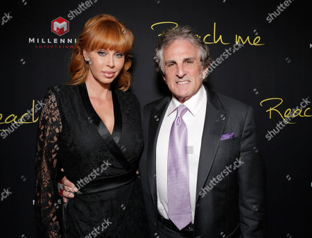 """Producer Rebekah Chaney and husband Director John Herzfeld attend the Los Angeles Premiere of Millenium Entertainment's """"Reach Me"""" at Chinese 6 Theaters on in Los Angeles"""
