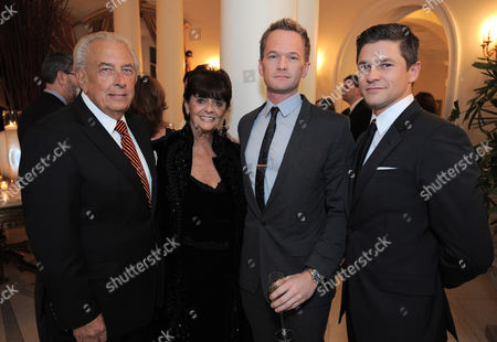 From left, Faye Mancuso, Frank Mancuso, Neil Patrick Harris and David Burtka attend the LOUIS XIII and Audi Chairman's Circle Dinner for the Geffen Playhouse on at a private residence in Los Angeles
