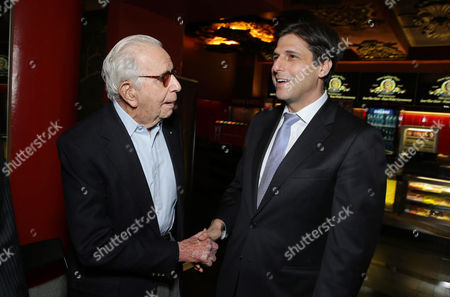 PREMIUM RATES APPLY Walter Mirisch and President, Motion Picture Group for MGM Jonathan Glickman kick off MGM's 90th Anniversary with the company's iconic mascot Leo the Lion's Paw Print ceremony at the TCL Chinese Theater in Hollywood on