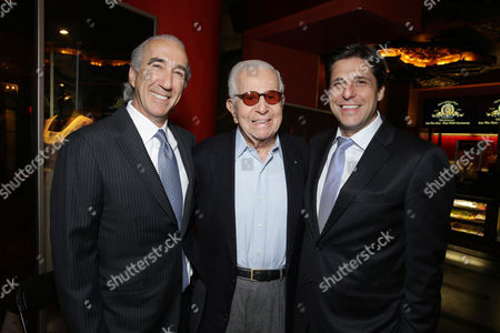 PREMIUM RATES APPLY MGM's Chairman and CEO, Gary Barber, Walter Mirisch and President, Motion Picture Group for MGM Jonathan Glickman kick off MGM's 90th Anniversary with the company's iconic mascot Leo the Lion's Paw Print ceremony at the TCL Chinese Theater in Hollywood on
