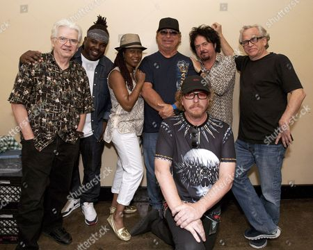 Toto band members David Hungate, Mabvuto Carpenter, Jenny Douglas, David Paich, Joseph Williams, Steve Lukather and Steve Porcaro posed for a photo before their performance as part of the Michael McDonald and Toto co-headlining tour at the Fox Theatre, in Atlanta, Ga