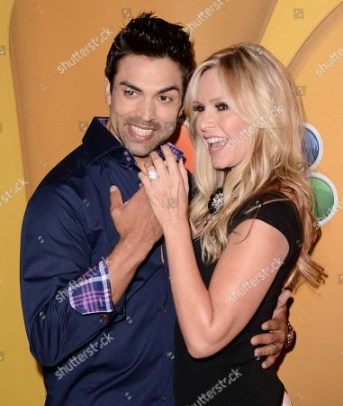 """Tamra Barney, right, and Eddie Judge from Bravo's """"Real Housewives of Orange County,"""" arrive at the NBC 2013 summer press tour at the Beverly Hilton Hotel on in Beverly Hills, Calif"""