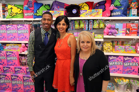 "Nick Cannon, left, joins Natasha Madan, Wonka Marketing Manager, center, Ross Ellis, founder and CEO of STOMP Out Bullying, and Wonka to celebrate 'NERDS Unite!"", an anti-bullying movement, and present $25,000 to STOMP Out Bullying at Dylan's Candy Bar on in Los Angeles. October is National Bullying Prevention Awareness Month"