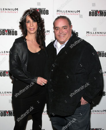 """Diana Benincasa, left, and actor Joe Gannascoli, right, attend a screening of """"Rob The Mob"""" on in New York"""