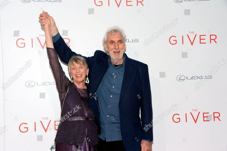 "Writer Lois Lowry, left, and director Phillip Noyce arrive at New York premiere of ""The Giver"" at the Zeigfeld Theater, in New York"