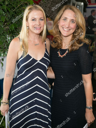 Stock Photo of Actress Melissa Joan Hart and Founder and Chief Shower Officer LeAnn Morrissey pose together at Operation Shower and Birdies for the Brave County Fair at Liberty National Golf Course on in Jersey City, NJ