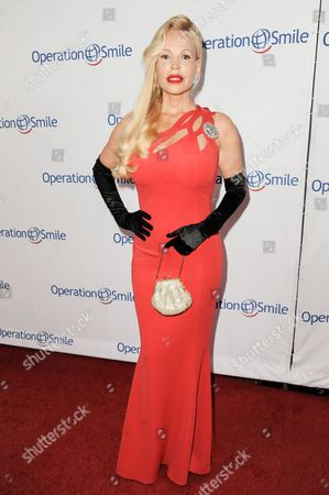 Stock Image of Brenda Dickson arrives at Operation Smile's 2014 Smile Gala, in Beverly Hills, Calif