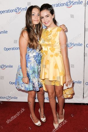 Neriah Fisher, left, and Bailee Madison arrive at Operation Smile's 2014 Smile Gala, in Beverly Hills, Calif