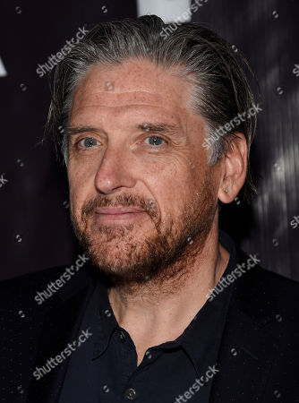 "Comedian Craig Ferguson poses at P.S. Arts' ""the pARTy!"" at Neuehouse, in Los Angeles"