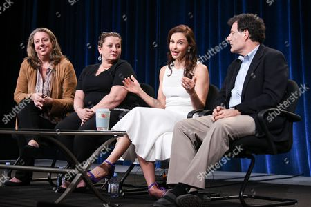 """From left, Maro Chermayeff, Shana Goodwin, Ashley Judd and Nicholas Kristof speak on stage during the Independent Lens """"A Path Appears"""" panel at the PBS 2015 Winter TCA, in Pasadena, Calif"""