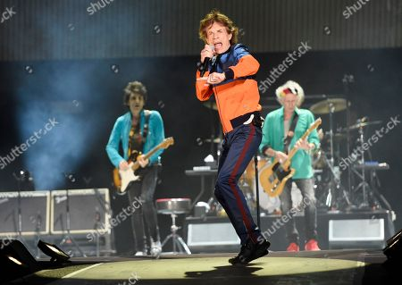 Mick Jagger, center, performs with Ron Wood, left, and Keith Richards of the Rolling Stones during their performance on day 1 of the 2016 Desert Trip music festival at Empire Polo Field in Indio, Calif. Jagger, the 73-year-old frontman of the Rolling Stones, was on hand at a New York hospital when girlfriend, Melanie Hamrick, gave birth to the couple son. According to a statement, both parents are delighted and mother and baby are doing well.â