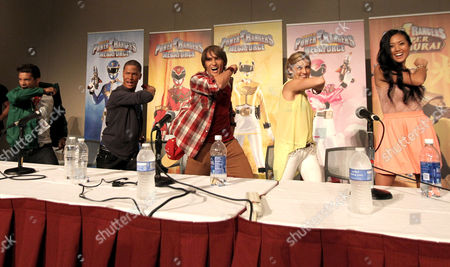 """The cast of """"Power Rangers Super Samurai"""" participates in an exclusive Q&A panel at the Power Morphicon Convention 2012, on in Pasadena, Calif. From left, Green Ranger Mike, Hector David Jr., Blue Ranger Kevin, Najee De-Tiege, Red Ranger Jayden, Alex Heartman, Yellow Ranger Emily, Brittany Pirtle, and Pink Ranger Mia, Erika Fong, pose for fans"""
