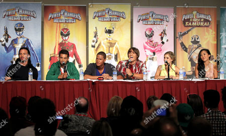 """Stock Picture of The cast of """"Power Rangers Super Samurai"""" participates in an exclusive Q&A panel at the Power Morphicon Convention 2012, on in Pasadena, Calif. From left, Deker, Rick Medina, Green Ranger Mike, Hector David Jr., Blue Ranger Kevin, Najee De-Tiege, Red Ranger Jayden, Alex Heartman, Yellow Ranger Emily, Brittany Pirtle, and Pink Ranger Mia, Erika Fong, answers questions from fans"""