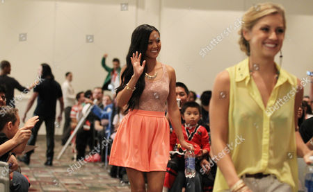 """Power Rangers Super Samurai"""" cast members Erika Fong, left, and Brittany Pirtle walk into an exclusive Q&A panel at the Power Morphicon Convention 2012, on in Pasadena, Calif"""