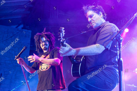 Adam Duritz and David Immergluck with Counting Crows performs during the Somewhere Under Wonderland Tour 2015 at Chastain Park Amphitheater, in Atlanta