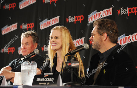 From left, John C. McGinley, Janet Varney and Dana Gould speak onstage during the Stan Against Evil NY Comic Con Panel at Javits Center, in New York
