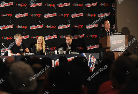 From left, John C. McGinley, Janet Varney, Dana Gould and Eric Goldman speak onstage during the Stan Against Evil NY Comic Con Panel at Javits Center, in New York