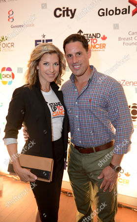 Carolyn MacKenzie, left, and Chris Stark arrive at Stand Up To Cancer Canada, in Toronto