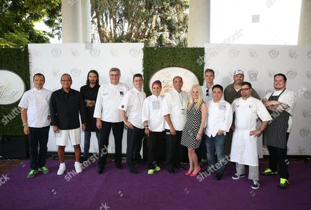 """Stock Image of From left, Chefs Susur Lee, Masaharu Morimoto, Fernando Darin, Maurice Keller, Ed Cooney, Norah Briceno, Michel Chammaa, Annette Starbuck, Lincoln Davies, Mesa Grill Los Vegas represetative, Jeffrey Strauss, Anthony Lamas, Matthew Lambert are seen at The Breeders' Cup """"A Taste of the World"""" event at the Huntington Library,, in San Marino Calif"""