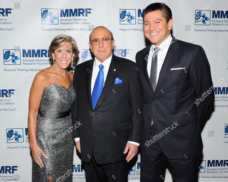 Founder and Chief Executive Officer of the Multiple Myeloma Research Foundation, Kathy Giusti, left, Clive Davis and Carl Quintanilla attend the Multiple Myeloma Research Foundation at the 15th Anniversary Fall Gala supporting cancer research on in Greenwich, Conn