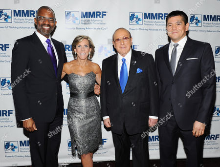 From left, Onyx CEO Anthony Coles, founder and Chief Executive Officer of the Multiple Myeloma Research Foundation, Kathy Giusti, Clive Davis and Carl Quintanilla attend the Multiple Myeloma Research Foundation at the 15th Anniversary Fall Gala supporting cancer research on in Greenwich, Conn
