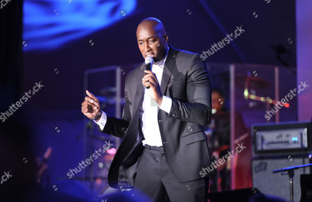 Stock Image of Jermaine Paul performs during the Multiple Myeloma Research Foundation at the 15th Anniversary Fall Gala supporting cancer research on in Greenwich, Conn