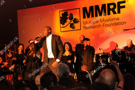 Stock Photo of Jermaine Paul performs during the Multiple Myeloma Research Foundation at the 15th Anniversary Fall Gala supporting cancer research on in Greenwich, Conn
