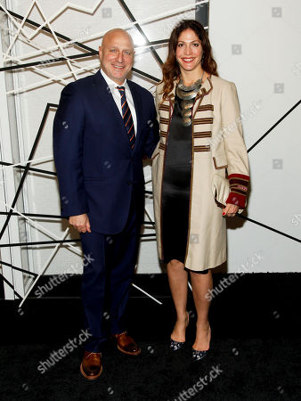 Tom Colicchio, left, and Lori Silverbush, right, attend the The Museum of Modern Art Film Benefit 2014, in New York