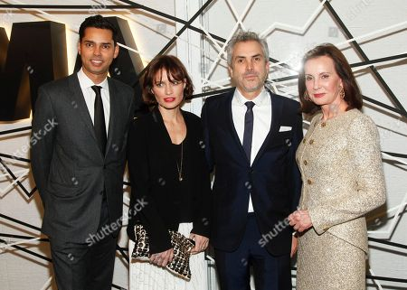 Rajendra Roy, from left, Sheherazade Goldsmith, Alfonso Cuaron and Marie-Josee Kravis attend the The Museum of Modern Art Film Benefit 2014, in New York