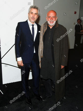 Alfonso Cuaron, left, and Francesco Clemente, right, attend the The Museum of Modern Art Film Benefit 2014, in New York