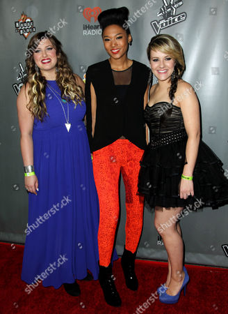 """Stock Image of Sarah Simmons, left, Judith Hill, center, Amber Carrington pose from Team Adam pose together at """"The Voice"""" season 4 red carpet event at the House of Blues on in Los Angeles"""