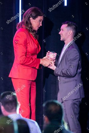 Caitlyn Jenner, left, and honoree Rhys Ernst on stage during the Voices on Point Gala at the Hyatt Regency Century City on in Los Angeles