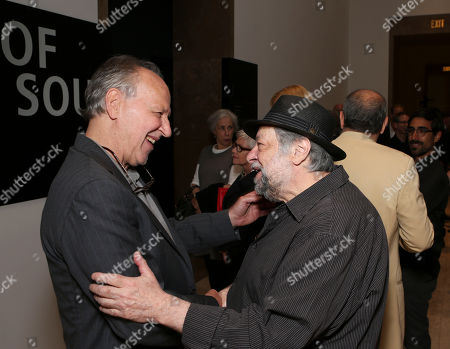 "From left, Werner Herzog and actor Ricky Jay celebrate during the opening of ""Hearsay Of The Soul"" filmmaker Werner Herzog's video installation at the Getty Museum, in Los Angeles, Calif"