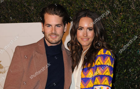 Stock Photo of Louise Roe, right, and Josh Slack arrive at the World Gold Council event at Selma House at Chateau Marmont, in Los Angeles
