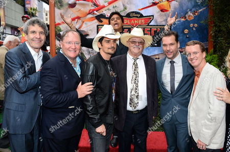 """L-R) Disney Chairman Alan Horn, Pixar chief creative officer/Executive Producer John Lasseter, singer Brad Paisley, Erik Estrada, actor Barry Corbin, actor/comedian Dane Cook and director Roberts Gannaway attend the world premiere of """"Planes: Fire And Rescue"""" at El Capitan Theatre, in Los Angeles"""