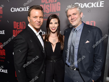 """Producer Tomas Harlan, from left, Meghan Ory and Executive Producer Tim Carter attend the world premiere of Crackle's """"Dead Rising Watchtower"""" at Sony Pictures Studios, in Culver City, Calif"""