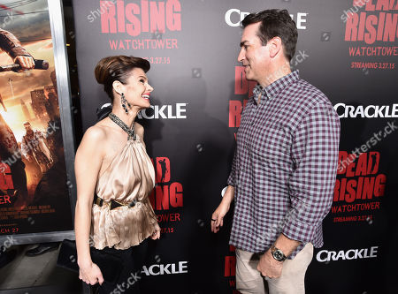 """Carrie Genzel, left, and Rob Riggle attend the world premiere of Crackle's """"Dead Rising Watchtower"""" at Sony Pictures Studios, in Culver City, Calif"""