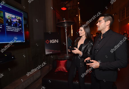 """Meghan Ory, left, and Jesse Metcalfe attend the world premiere of Crackle's """"Dead Rising Watchtower"""" at Sony Pictures Studios, in Culver City, Calif"""