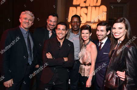"""Stock Photo of Producer Tim Carter, from left, Aleks Paunovic, Jesse Metcalfe, Dennis Haysbert, Carrie Genzel, director Zach Lipovsky and Meghan Ory attend the world premiere of Crackle's """"Dead Rising Watchtower"""" at Sony Pictures Studios, in Culver City, Calif"""